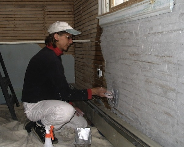 plastering the wall